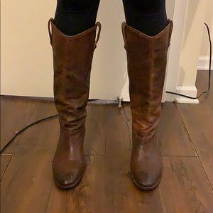 Tall brown Frye cowboy boot
